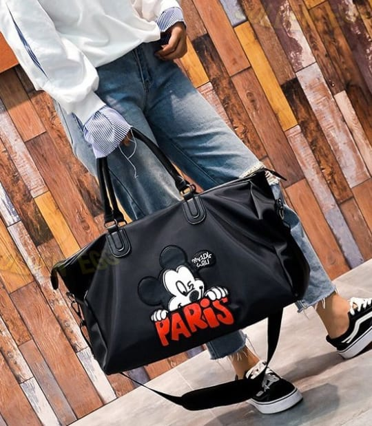 f33ff72a30f7a This Disney Travel bag is great to bring around for your travels. There is  plenty of space to put your belongings and it comes with a strap!